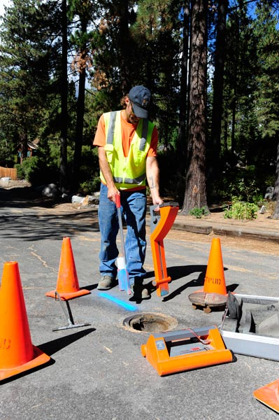 north tahoe utility worker marking the ground with spray paint