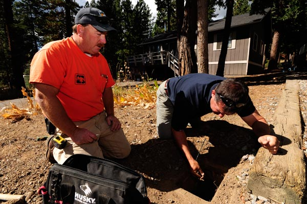 north tahoe utilities workers working on a hole in the ground