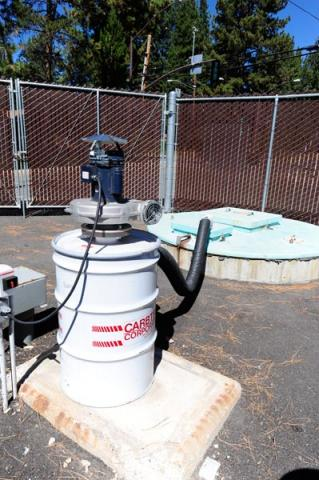 a water tank with a pump on top of it