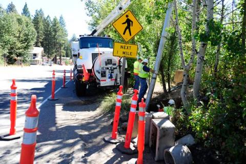 north tahoe utilities workers holding pipe