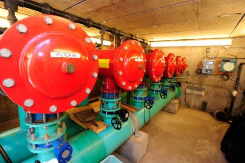 mechanical room with water pipes and valves