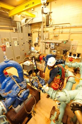 north tahoe utility worker in a mechanical room servicing pumps