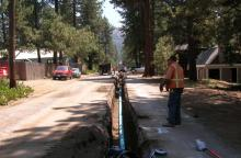 new water line in a trench dug down a street